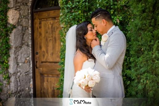 Bell Tower 34th Houston Wedding Photography Portraits Bride Groom Kiss Pose MnMfoto